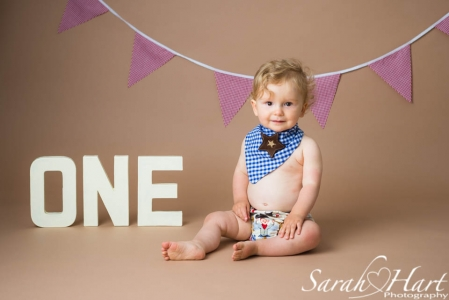 Cowboy theme cake smash photography session, available for babies aged one, photography by Sarah Hart