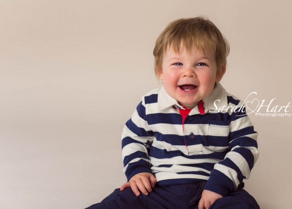 toothy grin, baby smiles, photographer of babies and children, Kent and surrounding areas