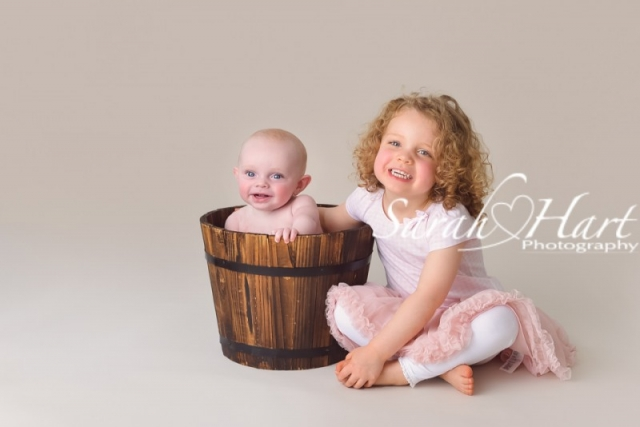 Siblings, baby and child photographer in Kent, baby in a bucket, baby soft skin, Tonbridge