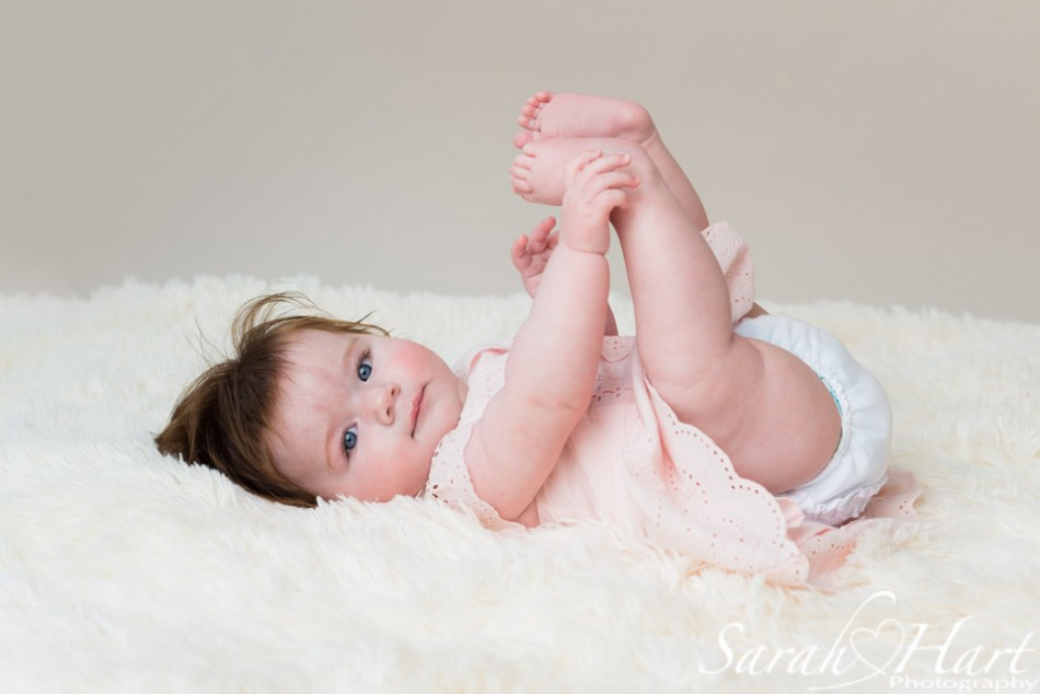 Baby holding feet, baby pictures, frilly pants, baby portrait