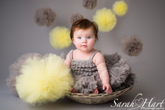 Pom pom decorations, baby in a basket, sitting up unaided, tutu dress,  Kent