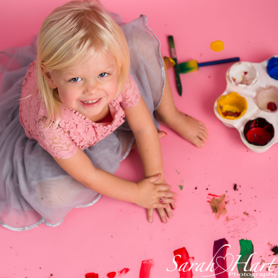 happy at her paint splash photo session, sevenoaks cake smash