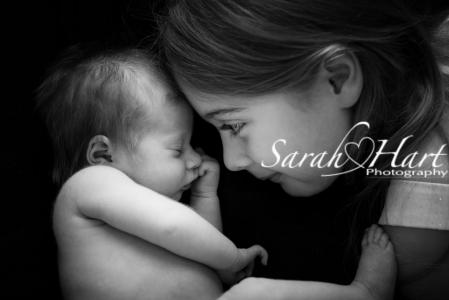 Kisses from big sister, baby pictures, memories to cherish, Tonbridge photographer