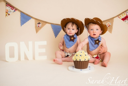 cowboy cake smash outfits, two little boys and a cake, studio photography, Hildenborough, Tonbridge