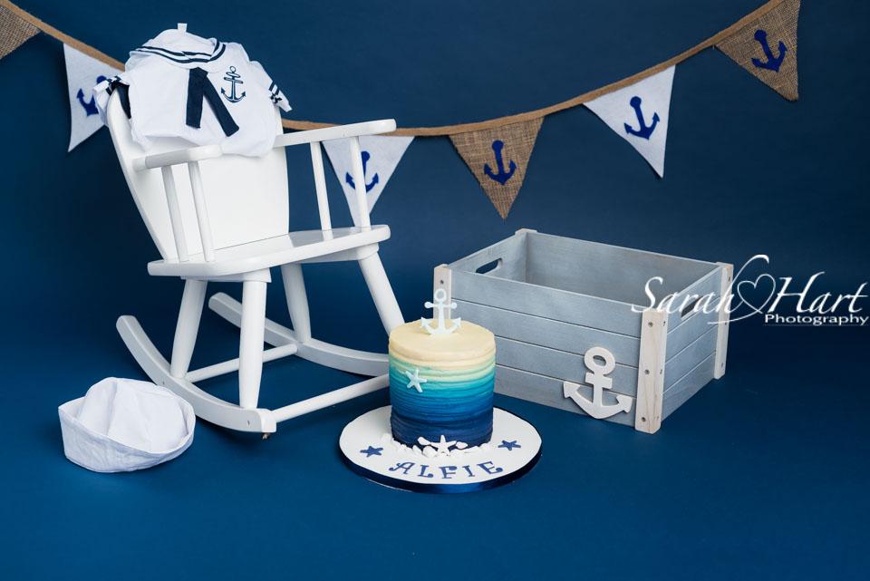 Sailor theme for first birthday photographs, cake smash photo by Sarah Hart Photography, Tonbridge photographer