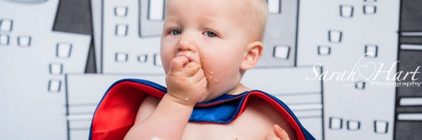 eat cake, first birthday portraits, Superhero theme, Kent photographer