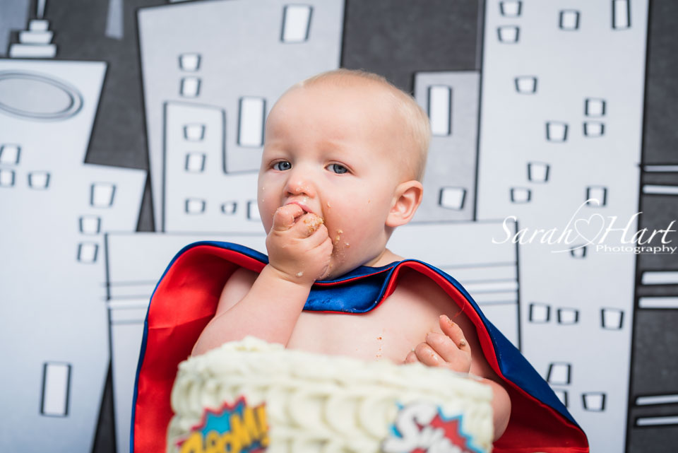 eat cake, first birthday portraits, Superhero theme, Kent photographer
