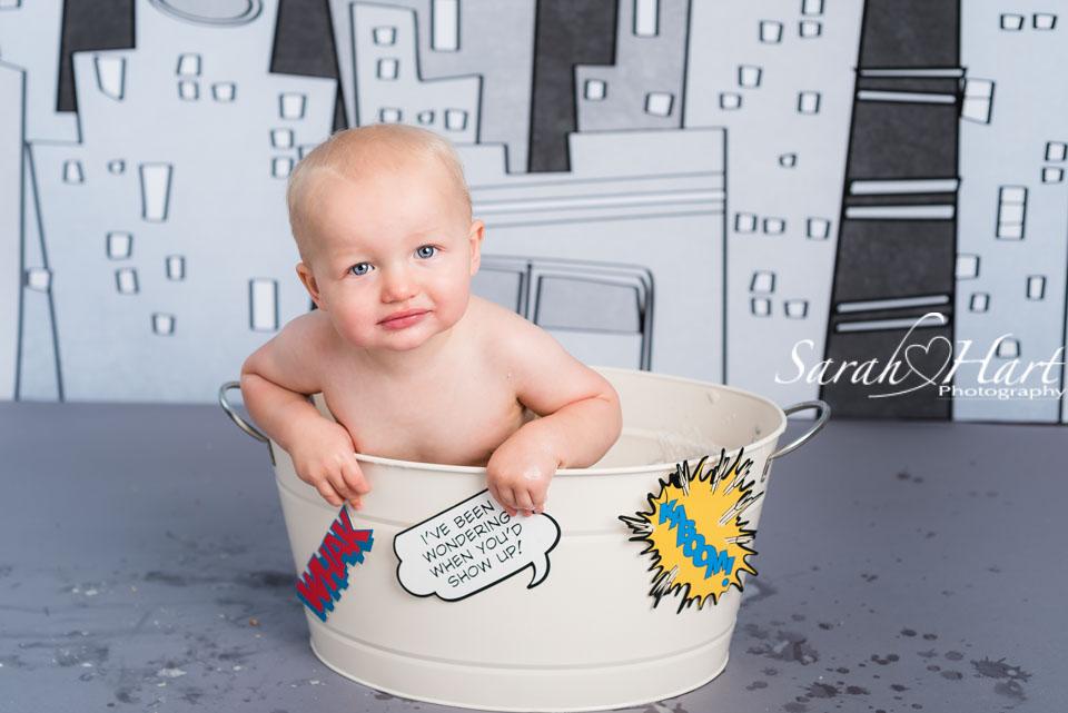 superhero splash time, first birthday photos, photography by Sarah Hart, Hildenborough photographer