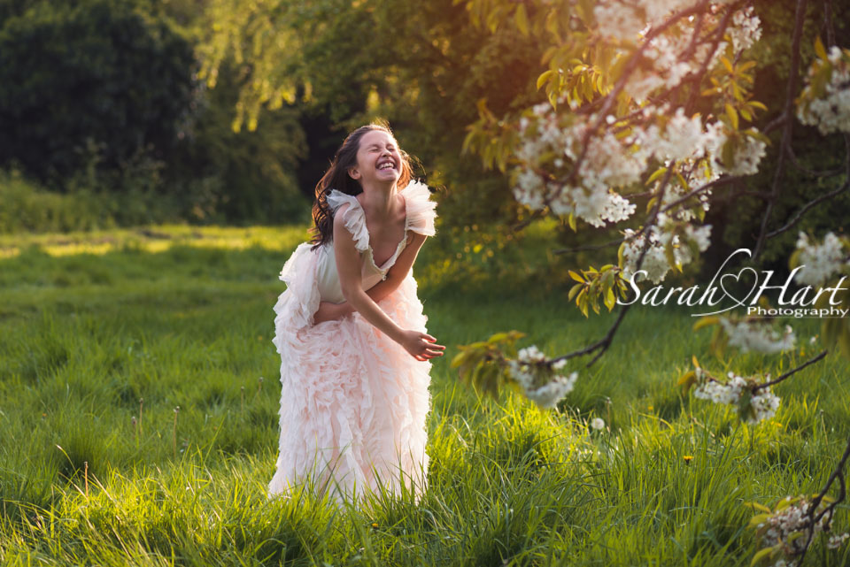 laughing in the blossom, cute smile, photography in kent