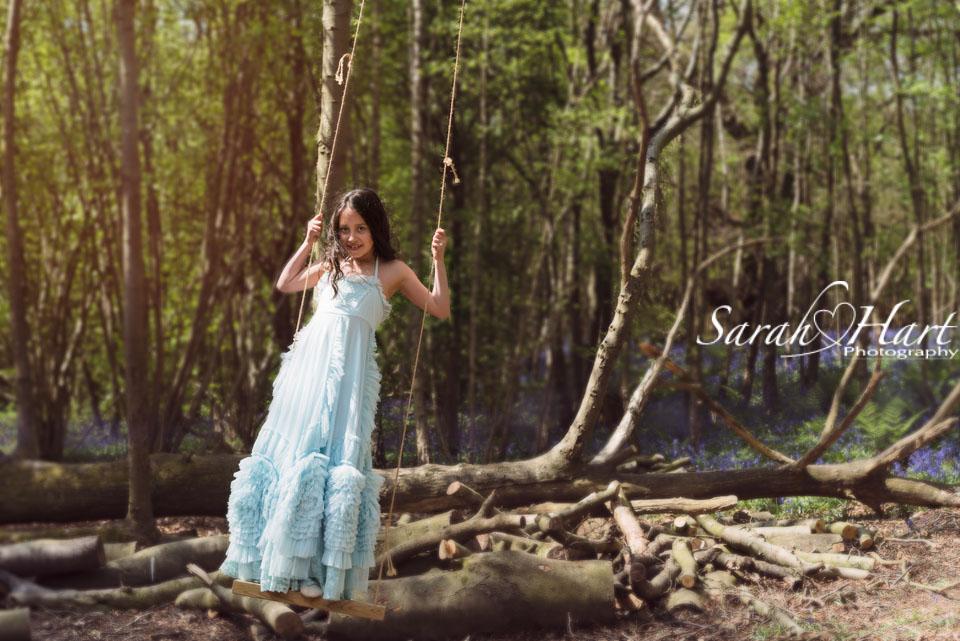 Girl on a swing, beautiful dress in the bluebells, Sevenoaks portrait photographer