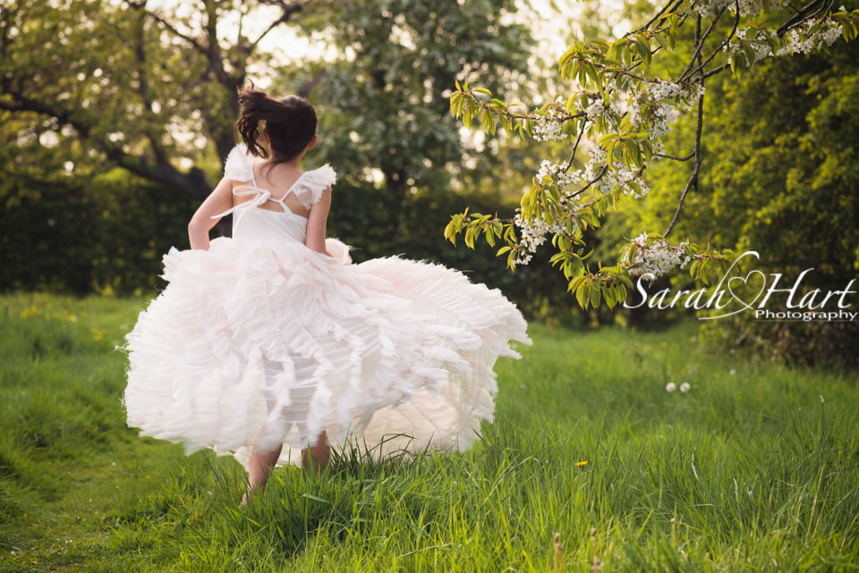 dancing in the meadow, West Malling, blossom trees, children's portrait photographer