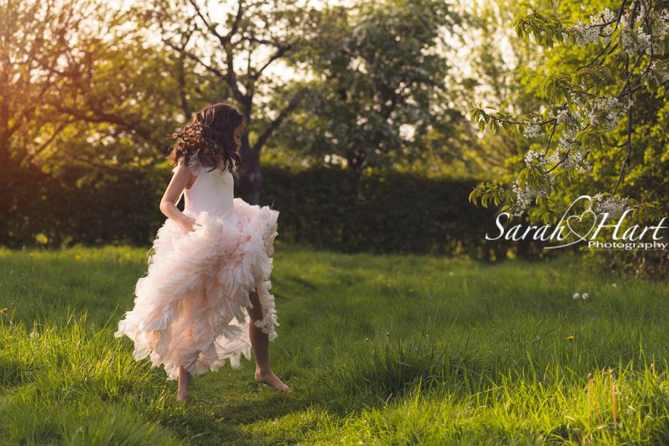 golden sunlight on girl dancing, blossom photo shoot, Kent photographer