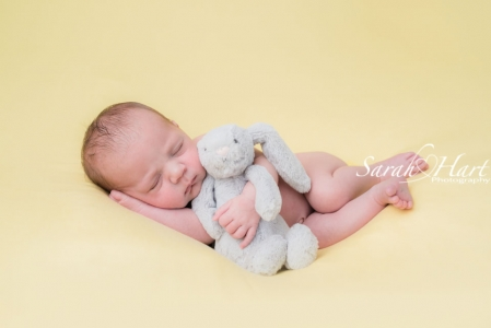 Newborn with her bunny, yellow and grey colours, newborn photographer west malling