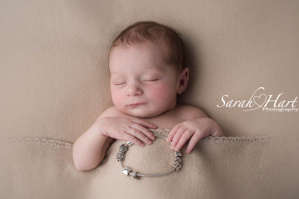 Sleeping baby with mums charm bracelet precious baby memories captured kent baby photographer