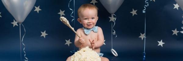 Silver stars, navy background fun cake smash, children's photographer West Malling, Kent