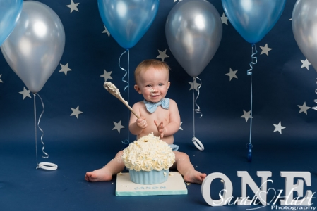 Silver stars, navy background fun cake smash, children's photographer West Malling, Kent