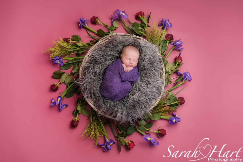 Baby wrapped for a photo shoot - swaddling aids sleep