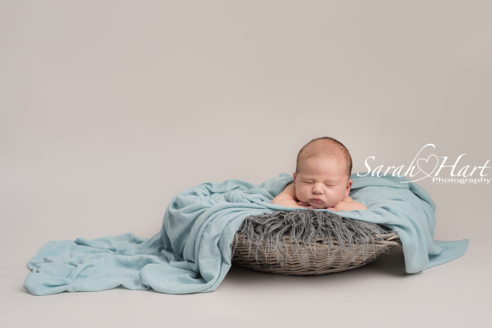 newborn in basket, pastel tones, best newborn photographer kent