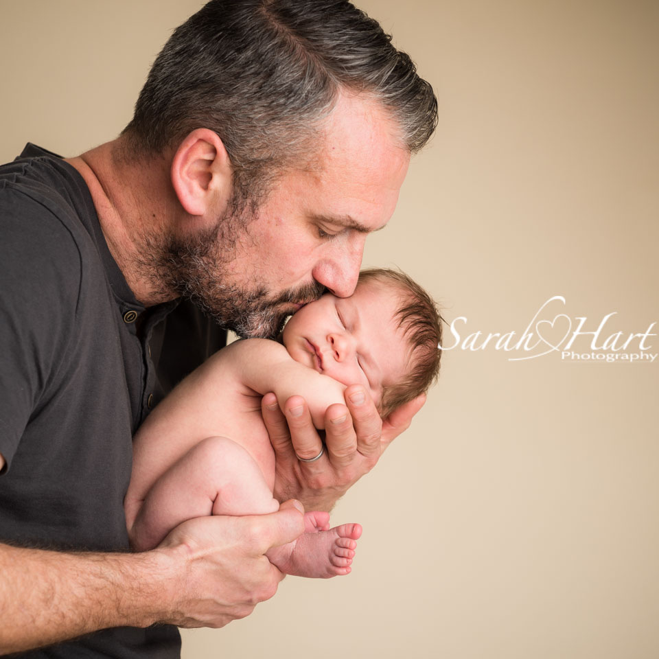 daddy kisses for newborn son , best baby photographer in kent