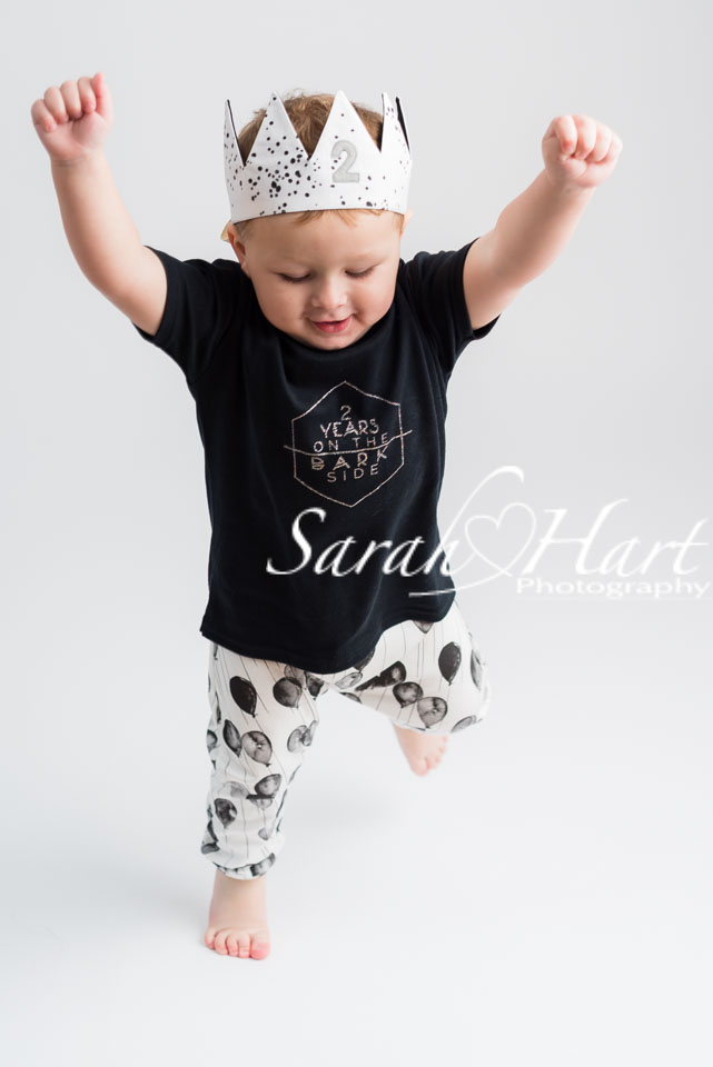 bouncing around toddler in photoshoot, Darkside clothing, Tunbridge Wells photographer