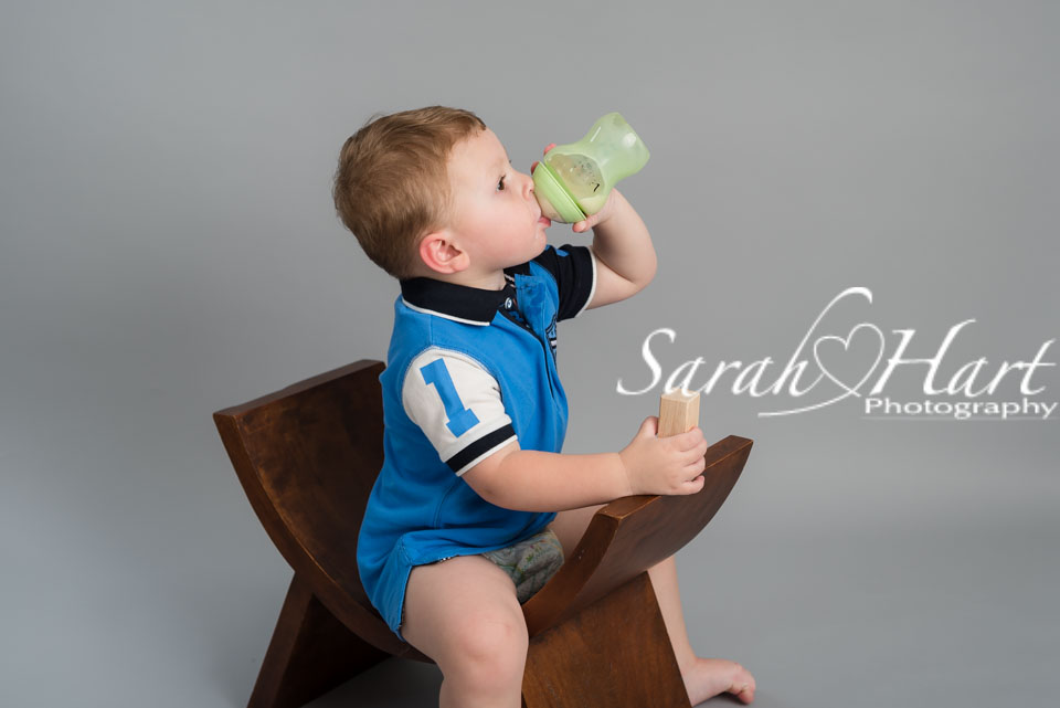 taking a milk break, tiring times in toddler photo shoot