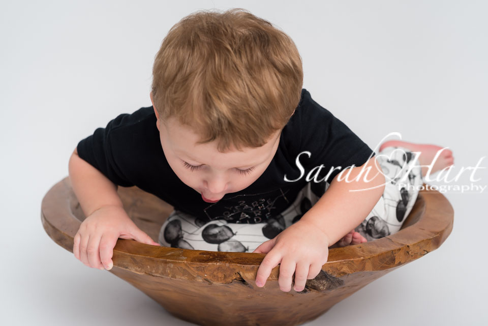toddler in a bowl, won't sit still for a photo, sevenoaks photographer