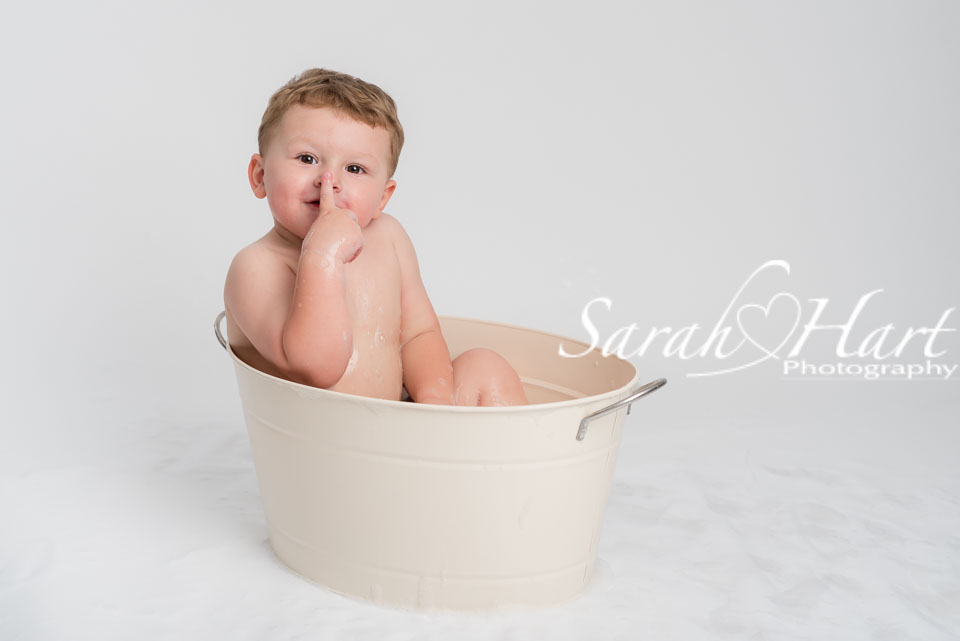 boy in a tin bath, cheeky moment tunbridge wells baby photo shoot