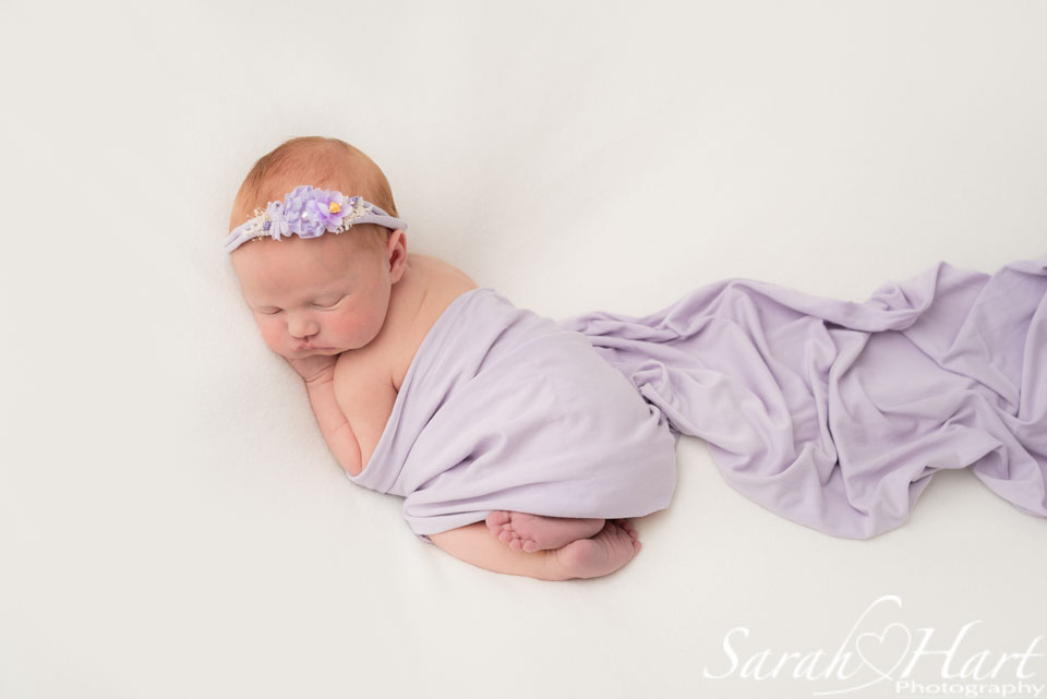 newborn photographer in tonbridge kent, lilac wrap and pretty lilac headband