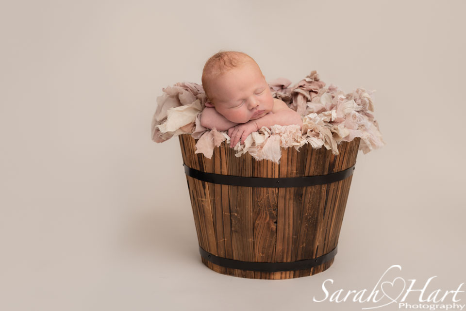 baby in pink ruffles, newborn baby photographer tunbridge wells
