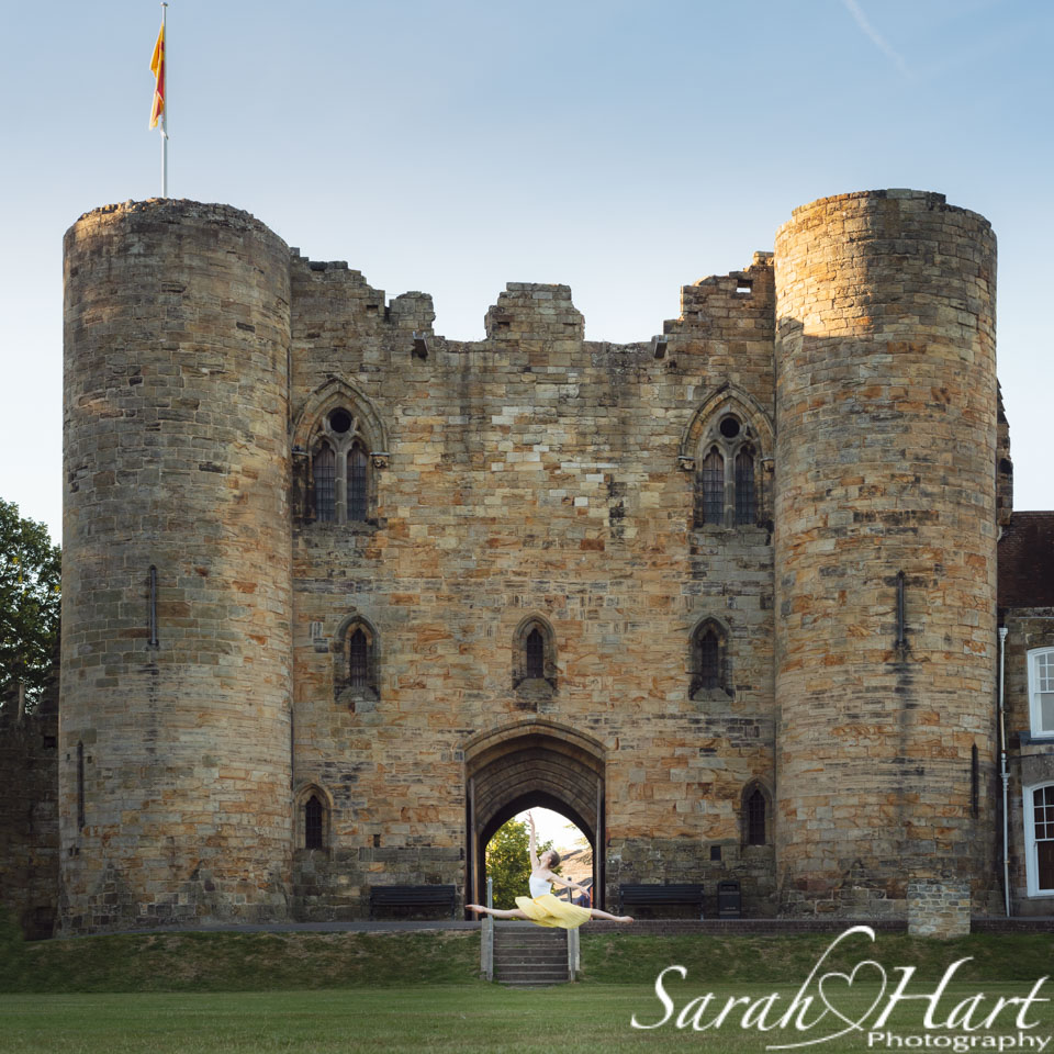 grand jete in front of Tonbridge castle. dance photographer Sarah Hart