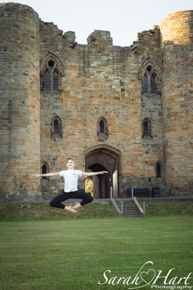 ballet leap, male dancer, ballet photo shoot in Tonbridge castle grounds
