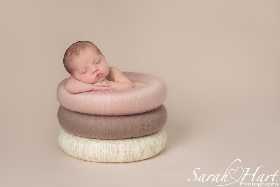 Baby in posing rings, neutral colours, simplicity, beautiful baby photography, Tonbridge Kent