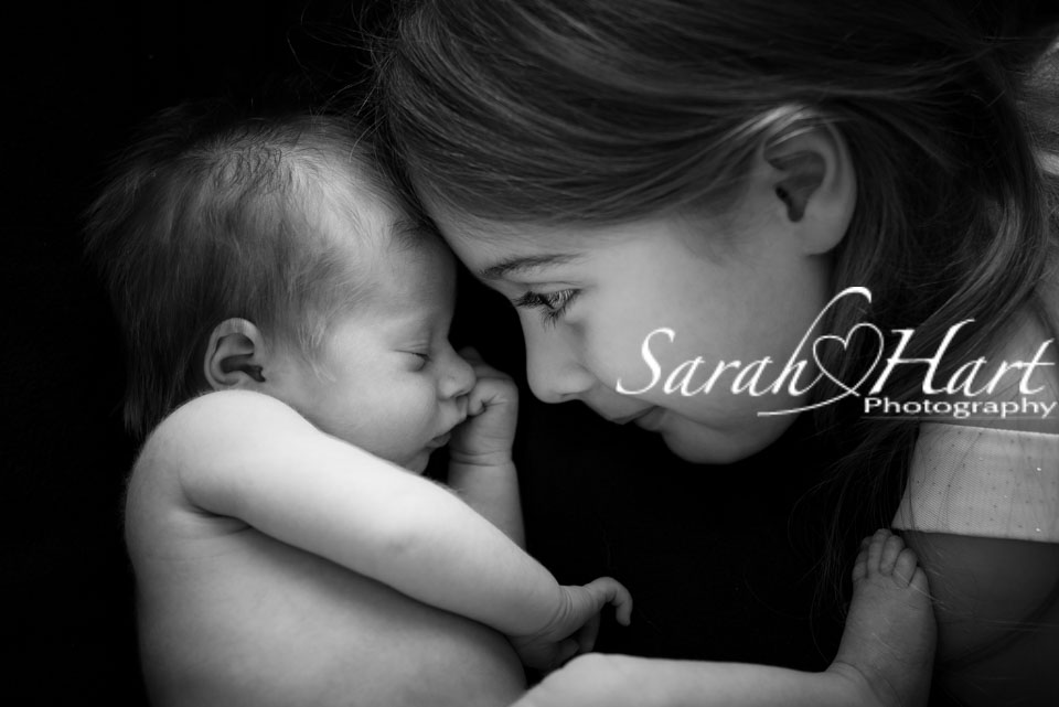 Kisses from big sister, baby pictures, memories to cherish, Tonbridge photographer