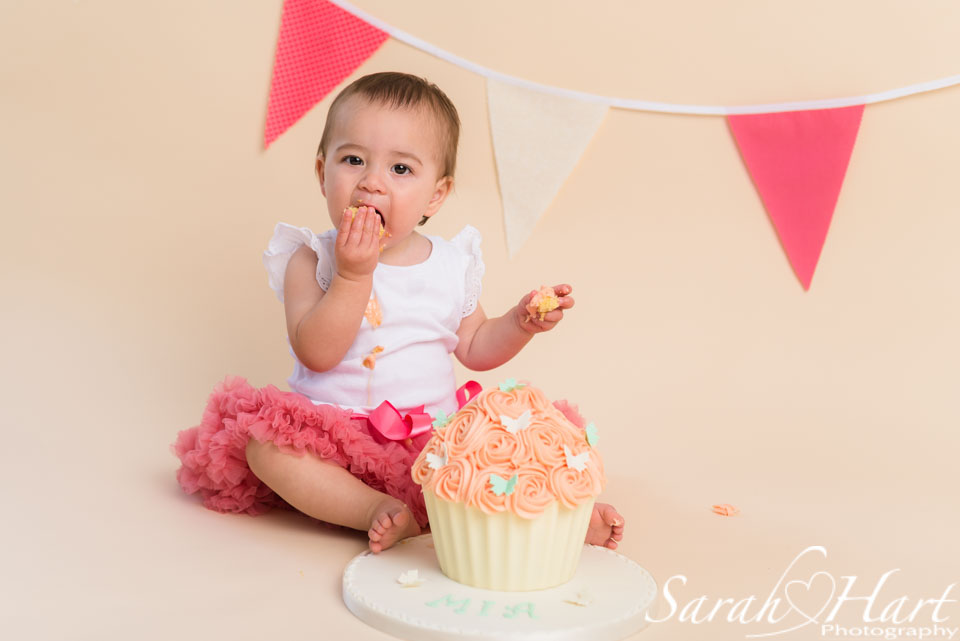 coral and mint cake smash colours, toddler eating cake, Tunbridge Wells cake smash