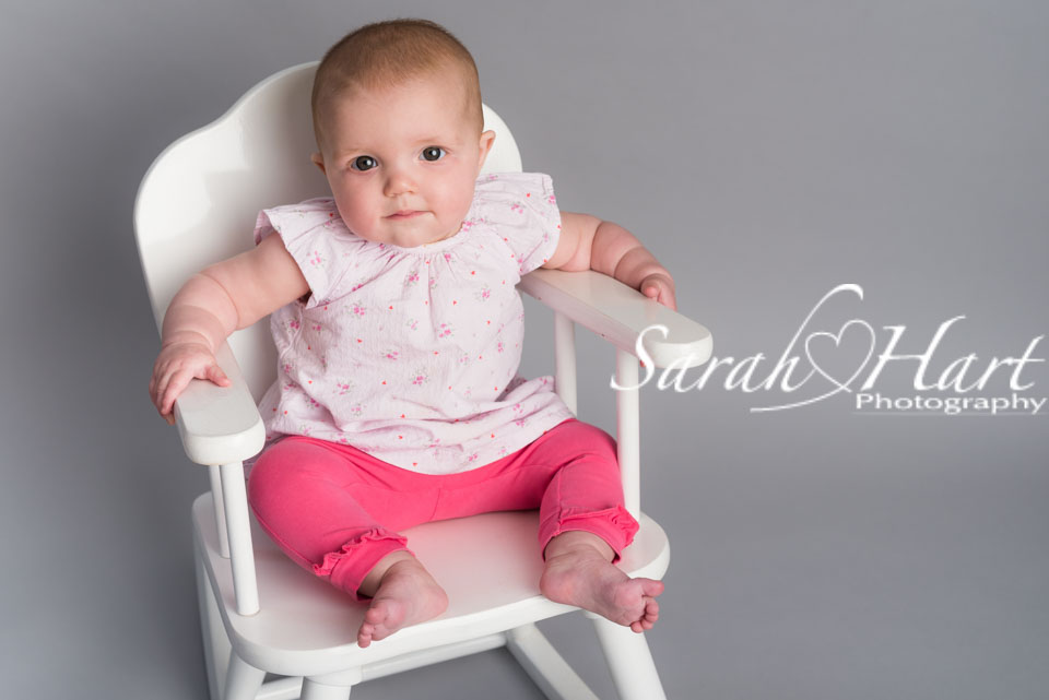 Baby sitting in wooden rocking chair, best Kent baby photographer, East Sussex, London, studio photography