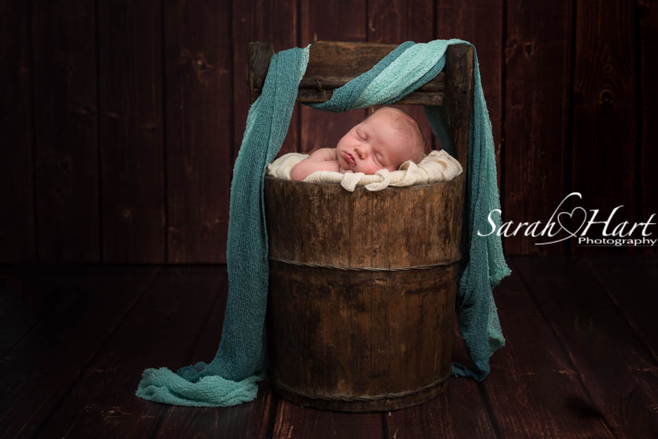 baby in a wooden bucket, tunbridge wells photographer, baby photo shoot kent