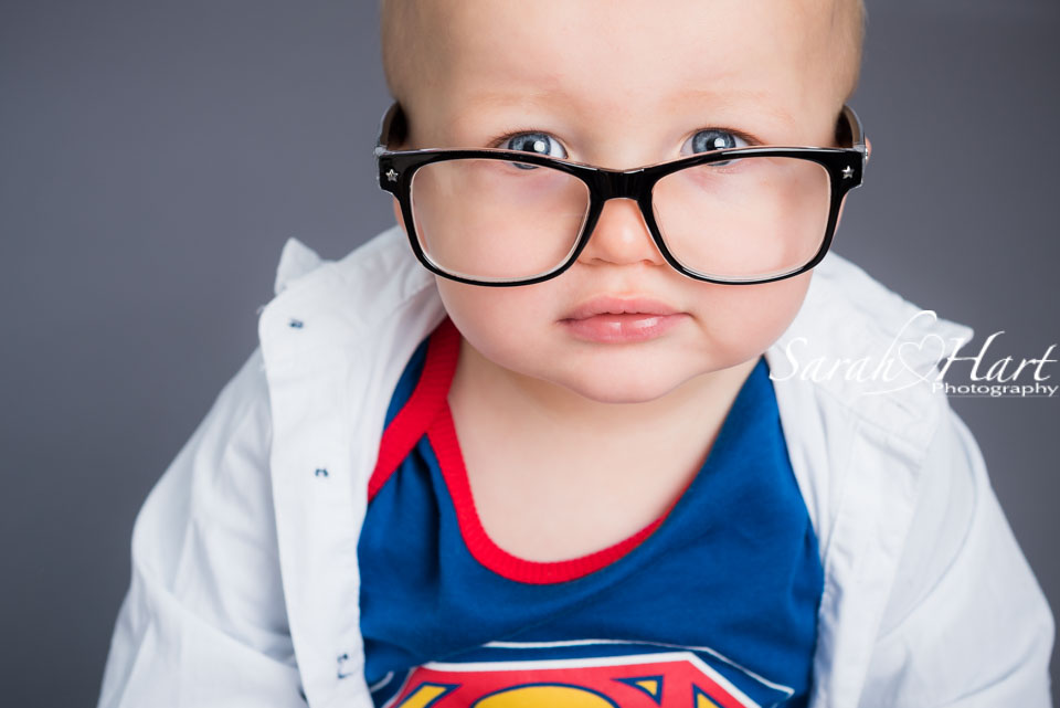 Clark Kent Superman baby photographs, Tunbridge Wells cake smash photoshoot