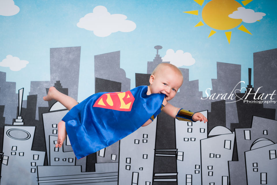Superman first birthday portrait, cake smash photography, Sevenoaks cake smash photographer