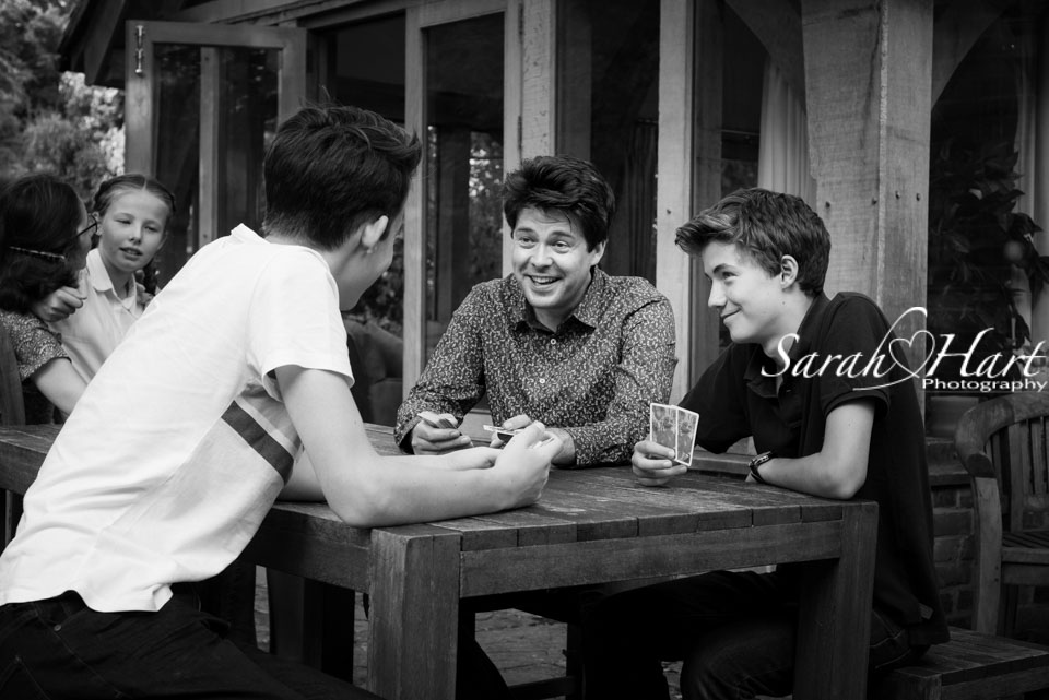family playing cards, family lifestyle photography, Sarah Hart, Tunbridge Wells photographer