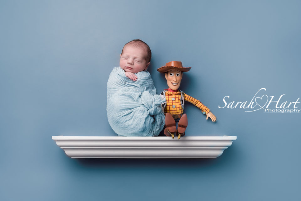 Shelfie, Newborn baby on shelf with Toy Story theme, Kent baby photographer