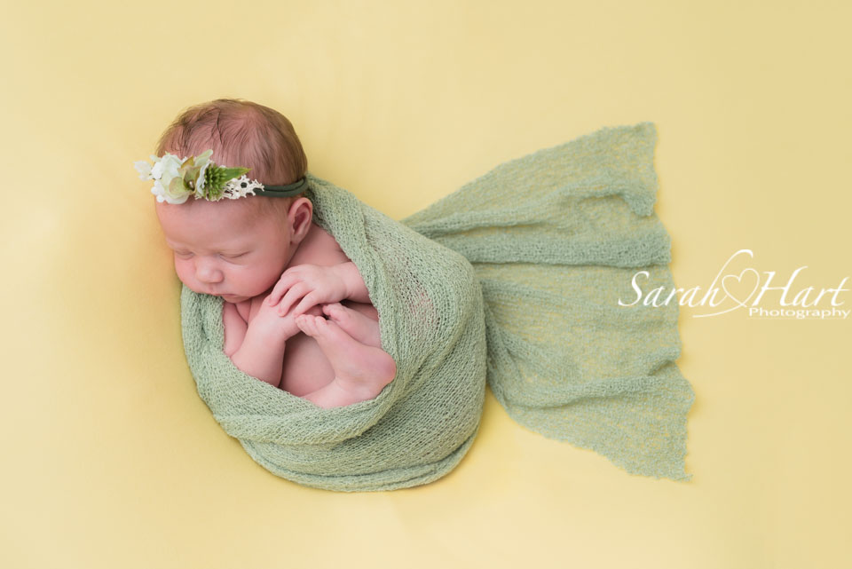 baby photoshoot Tonbridge Kent, spring colours, curled up newborn