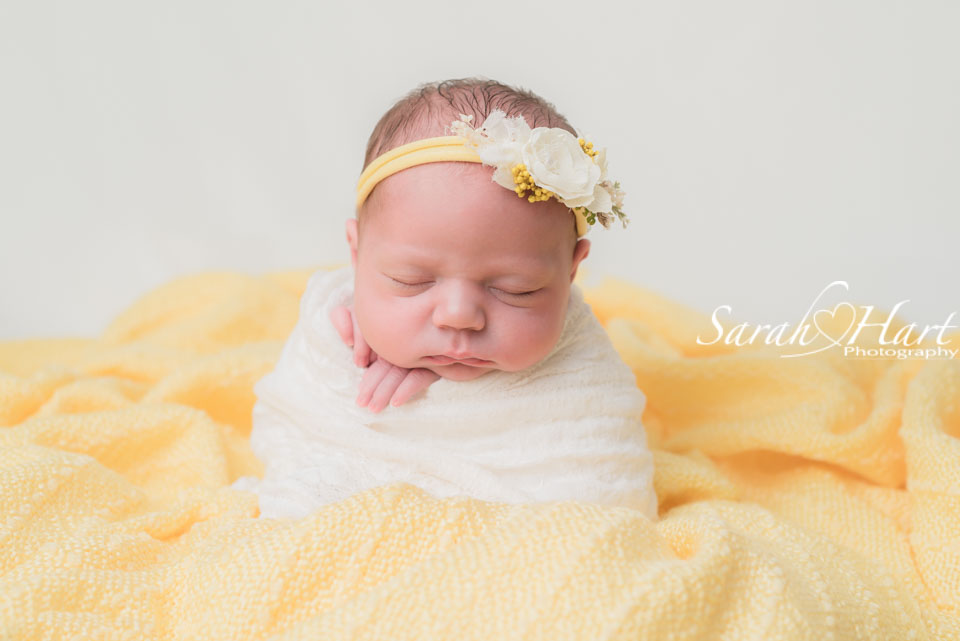 potato sack pose, newborn in spring colours, experienced newborn photographer Tunbridge Wells
