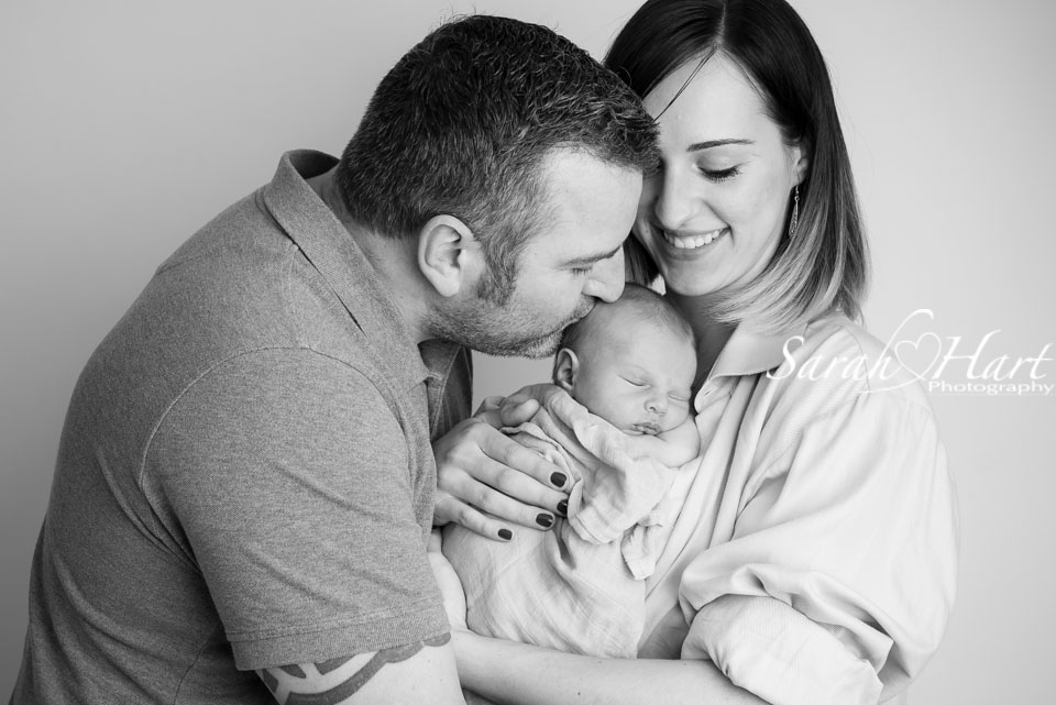 kisses and cuddles for your baby, memories captured by Sarah Hart, best newborn photographer kent