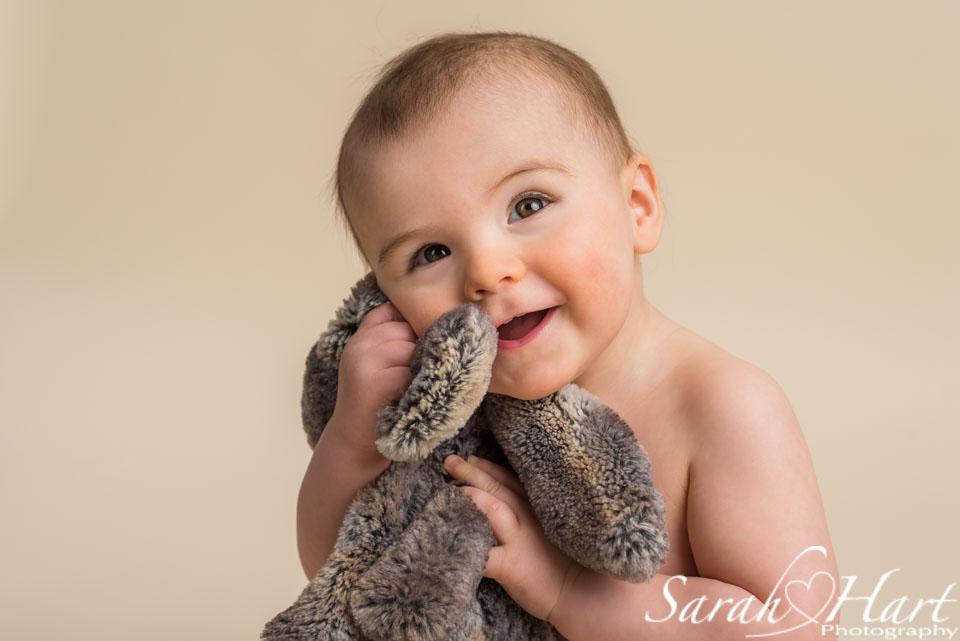 baby hugging bunny soft toy, beautiful smile, kent photographer