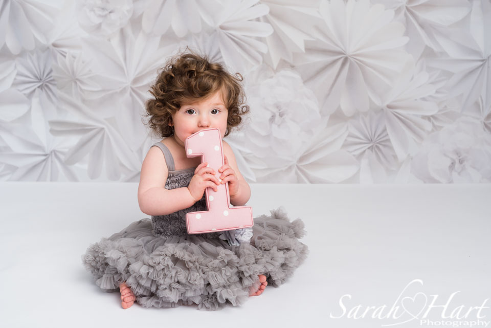 Floral backdrop and grey tutu dress for 1st birthday girl, Paddock Wood photographer