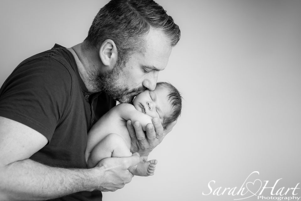 Precious bundle in Dad's hands, kisses for your baby, baby photography tonbridge