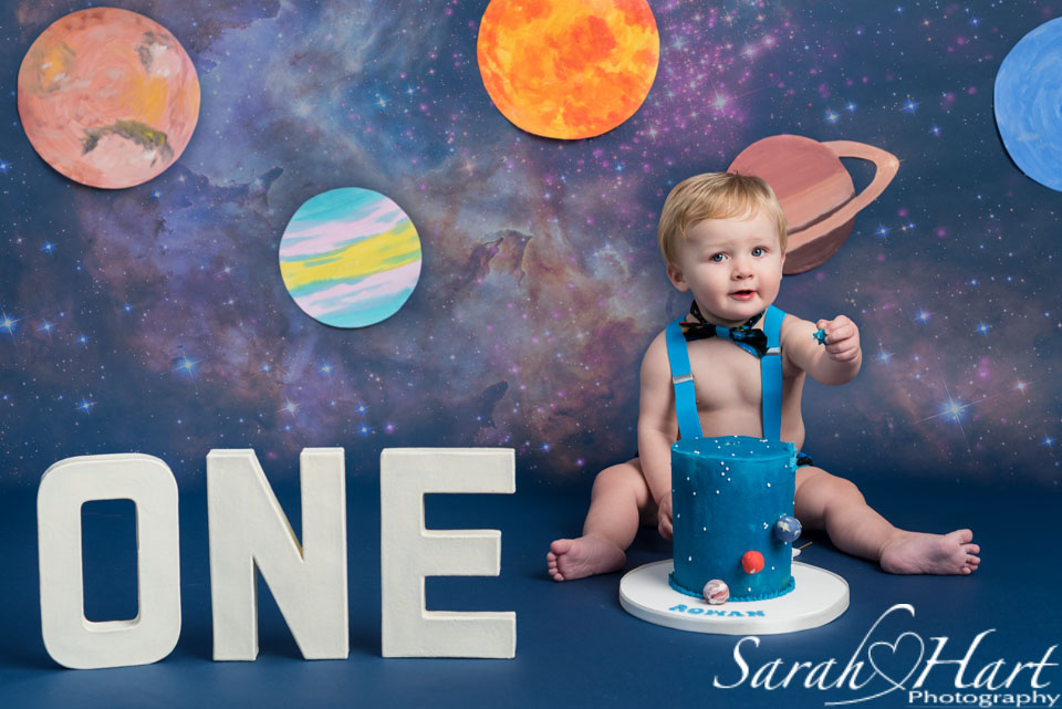 Space theme cake smash, navy backdrop, Hildenborough cake smash photographer