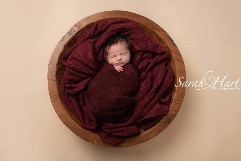 west malling newborn photographer, baby girl in deep red wrap
