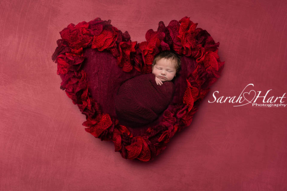 newborn on a red heart, best sevenoaks baby photography
