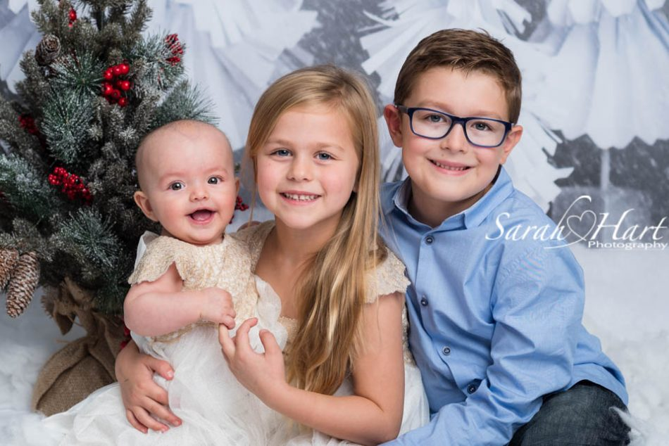 Xmas mini photography session, festive tree and siblings, Tonbridge photographer